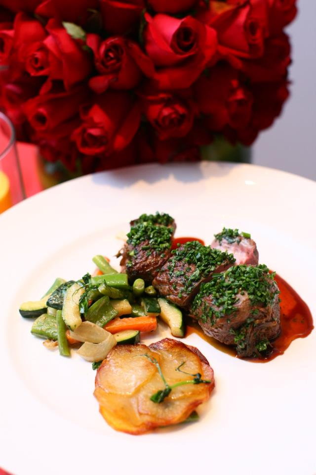 Lamb Loin and Shoulder Braised in Carlsberg Green, Pommes Anna and fresh market vegetables. Served with Carlsberg Green Label