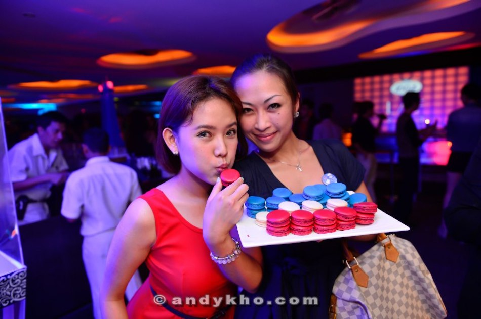 Esther and Aivee with some blue, white and red macarons - the colours of the french flag