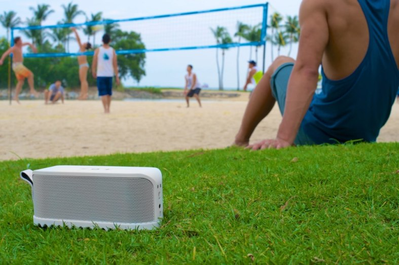 Take it outdoors! It's powerful enough that you can still hear the music clearly up to 10 feet away (speakers facing you of course)