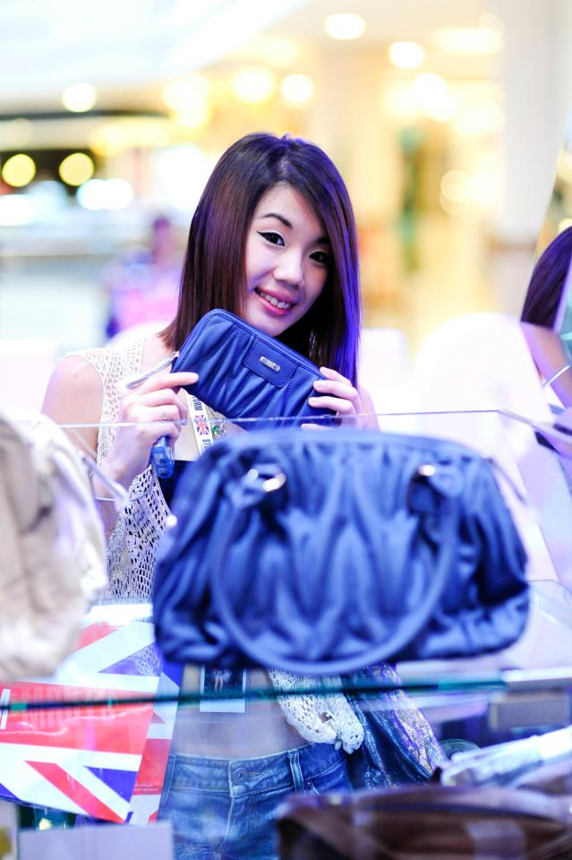 Jiayeen checking out their collection of bags