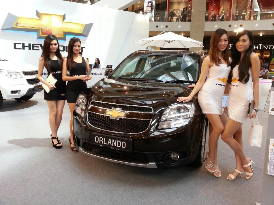 The promoter girls with the new Chevrolet Orlando which is an MPV
