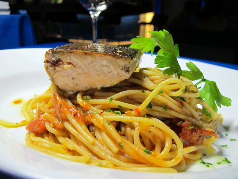 Spaghetti  aglio e olio with grilled  salmonChili flakes, garlic, extra virgin olive oil served with spicy tomato relish