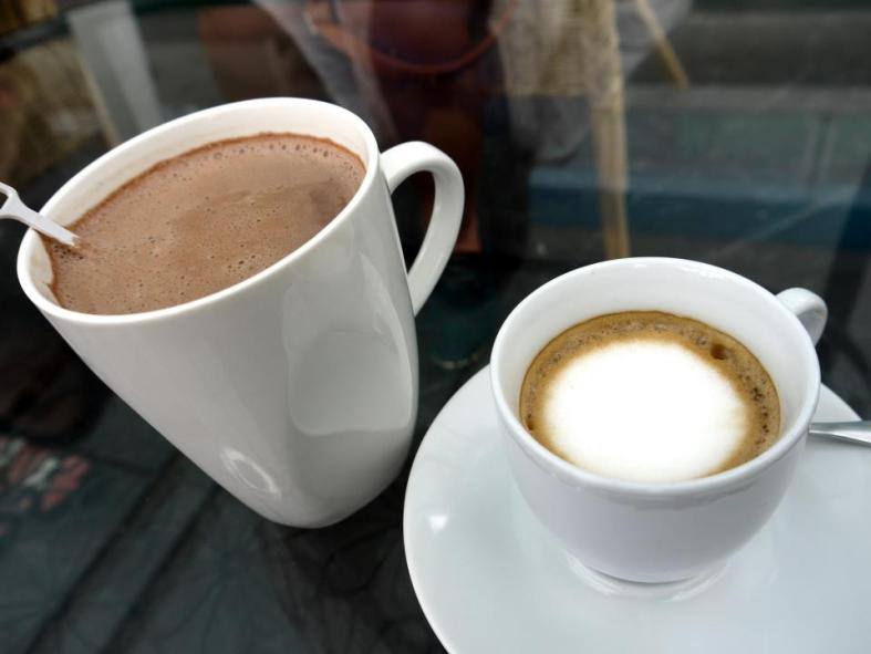 Hot chocolate (left) and a caffe macchiato which is an expresso marked with a little milk.
