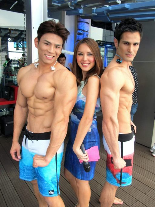 The sexy Julie Woon was posing with a couple of male models who were wearing the new Sony Walkman W270.