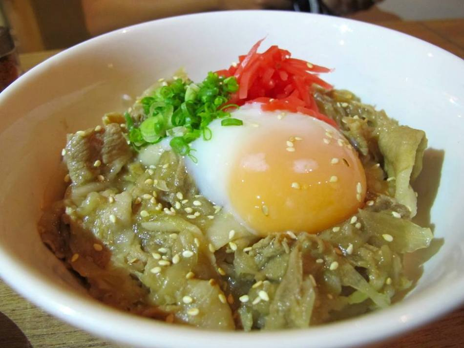 Buta don - pork with rice with an egg on top cooked Japanese style. Break the yolk and mix it well into the pork and rice. This one is a meal on it's own.