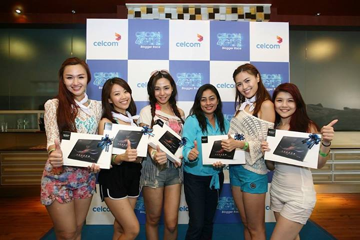 The White Team all smiles after receiving their tablets from Celcom First.