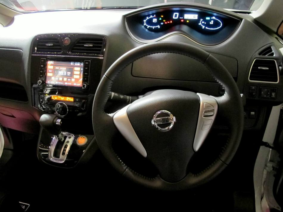The flowing dashboard design which houses the controls and 6.5-inch Multimedia Navigator with Rear View Camera, DVD player, iPod connectivity, USB & Bluetooth.