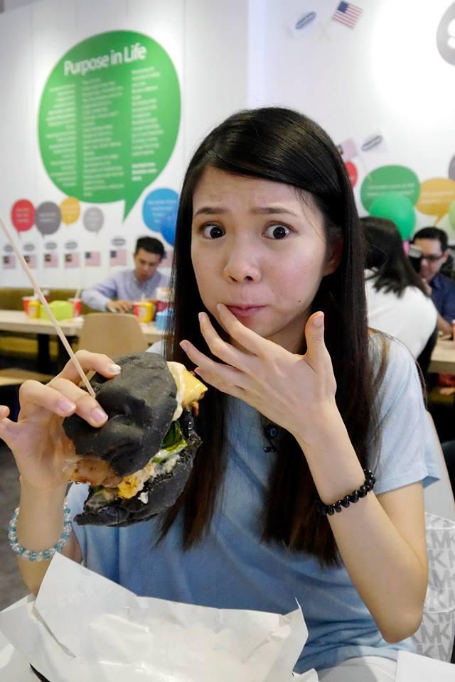 Mei Sze enjoying her burger