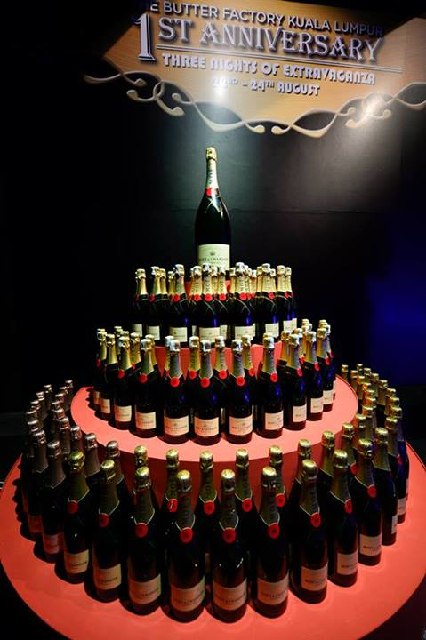 """The birthday """"cake"""" was made out of 111 bottles of Moet & Chandon champagne which were later given out to guests"""