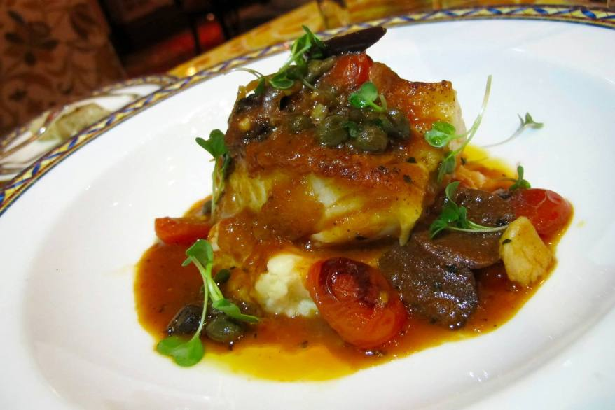 cod medallion stew with Mediterranean vegetables in tangy tomato sauce, lemon chick pea mousse.