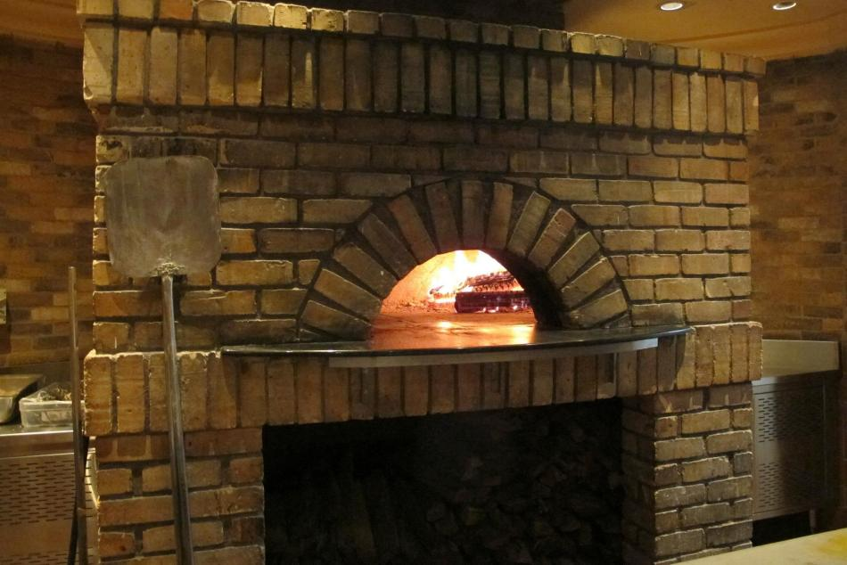 The restaurant has an open kitchen where you can watch the chefs prepare your food however it was the wood fire oven which is used to bake the pizzas which really caught my eye.