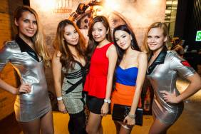 MHB's Sarah, Valerie and Stephanie Lim with the Asahi girls at the photowall