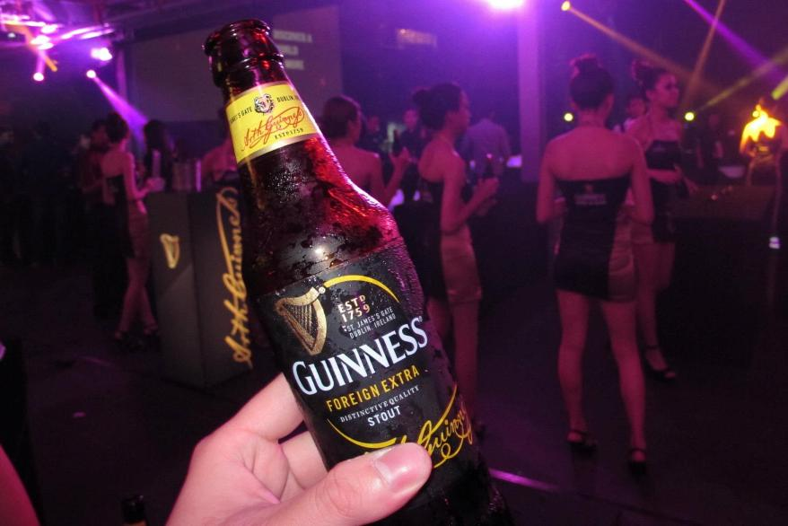 """The new design features metallic gold finishes, the standout yellow racetracks of colour and the layering of contemporary typography, while the iconic """"bull dog"""" (you know how your uncles and grandfathers will refer to Guinness as """"aw kow"""" or """"black dog""""? Well that's why) remains on the neck label as the classic icon of Guinness in Malaysia, and to round things off the Arthur Guinness' signature is a reminder of the drink's founder and heritage."""
