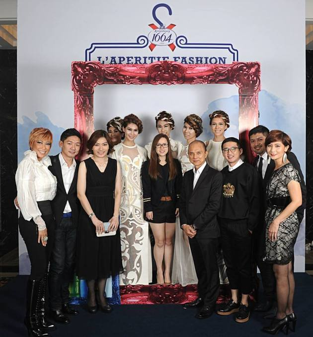 The winner with Dato Jimmy Choo, Juliet Yap the Marketing Director of Carlsberg Malaysia, and the judges