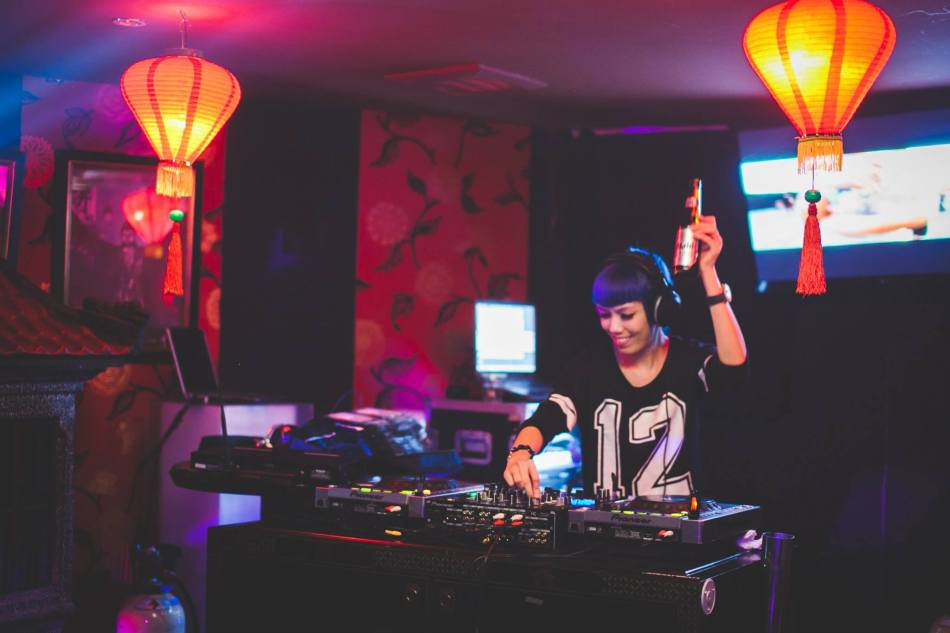 DJ Faith on the decks rocking funky blue hair!