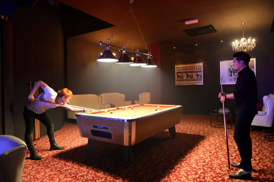 Wanna show off your pool skills or take a breather from the partying? Well there's a pool table for you to do just that.