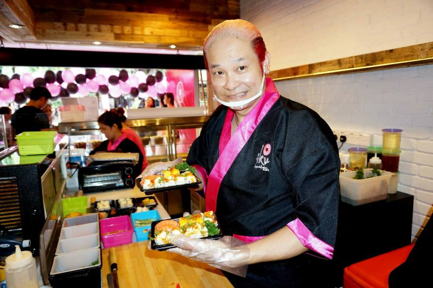 Despite working at a furious pace, Chef Yama still managed to pause, smile and pose for this shot.
