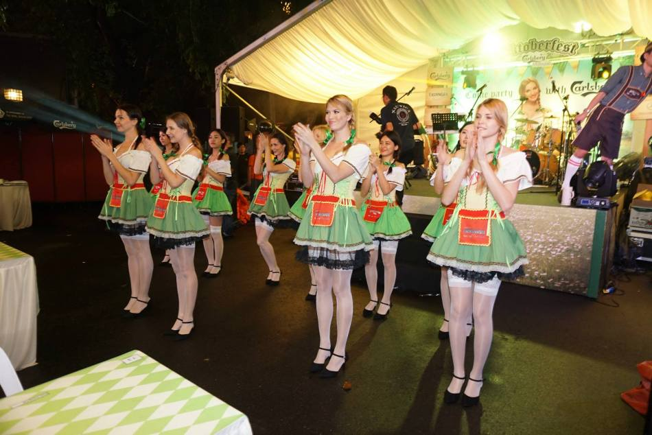 The Oktoberfest girls in the traditional dirndl will dance with you