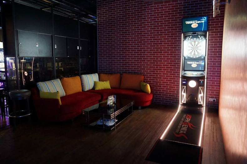 The outlet is mainly divided into 3 sections - the indoor sofa/ dining section, outdoor dining section and the darts/ bar section which has a private room with 2 machines and sofas (pictured here)