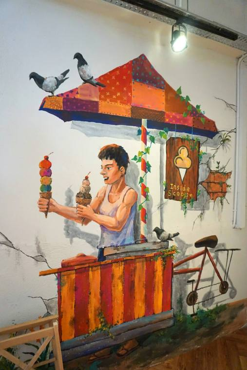 Mei Sze was quite impressed with the mural on the wall depicting an olden days ice cream seller
