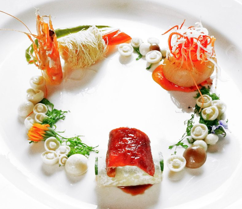 Pan-fried dragon beard prawn with green tea, stuffed Peking duck, seared Hokkaido scallop & mushroom blossom