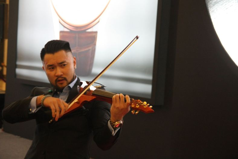 Malaysian violinist Dennis Lau, supported vocally by upcoming singer, Michael Leaner, entertained the guests