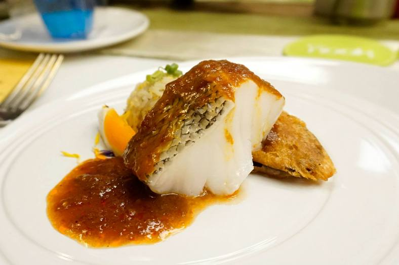 Cod Assam Pedas Sauce served with Garlic Rice, Salted Egg and Tempura Egg Plant