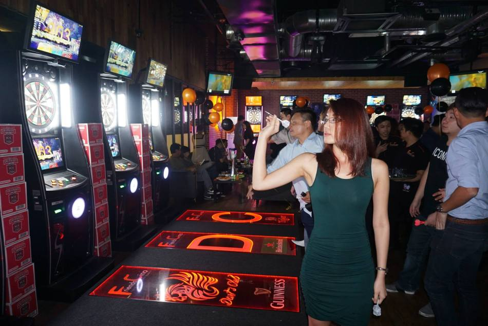 Meanwhile, some of the girls got addicted to playing darts inside the dart machines area