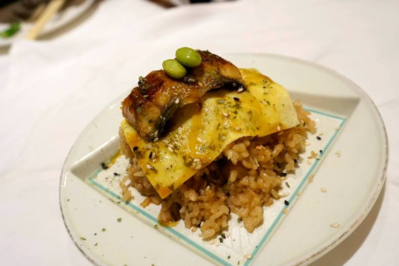 Unagi and mushroom rice wrapped in egg with honey teriyaki glaze