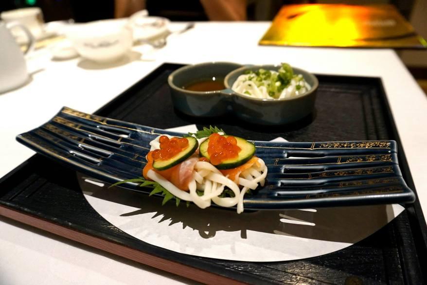 Salmon sashimi on cold inaniwa udon with ikura