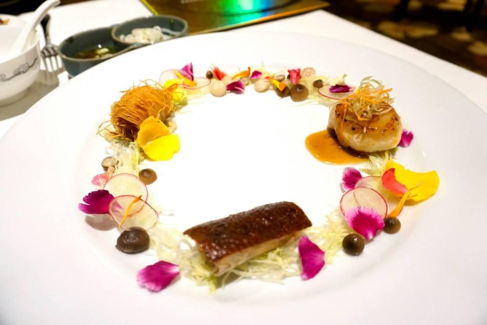 Pan-fried dragon beard prawn with green tea, stuffed Peking duck, seared Hokkaido scallop & mushroom blossom