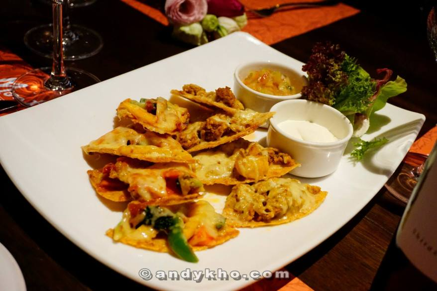 Nachos - A choice of chicken or vegetarian with cheddar cheese on crispy corn tortilla chips - RM19.00 Accompanied with guacamole and sour cream, and perfect for sharing! Love the jalapeno chillis on top too!