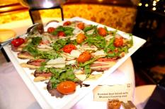Roasted beef salad with mustard dressing and arugula