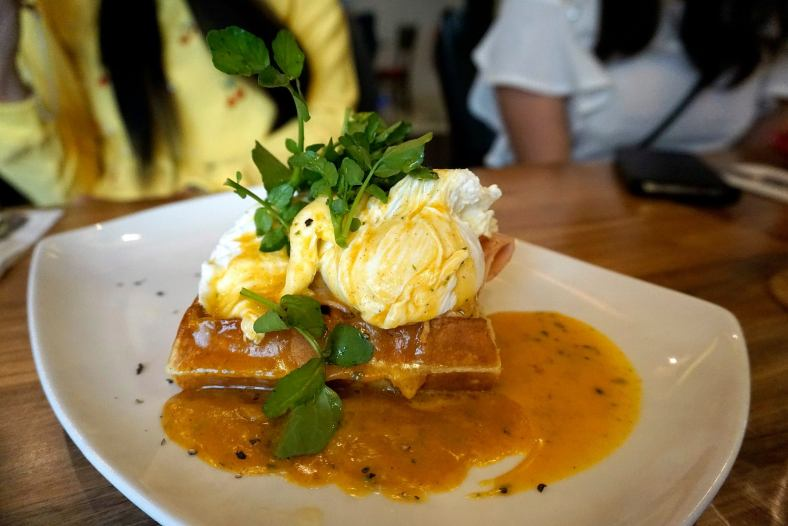 Down Home Benny - RM18.00 - waffle with beef bacon, poached eggs, hollandaise sauce, avocado and watercress salad