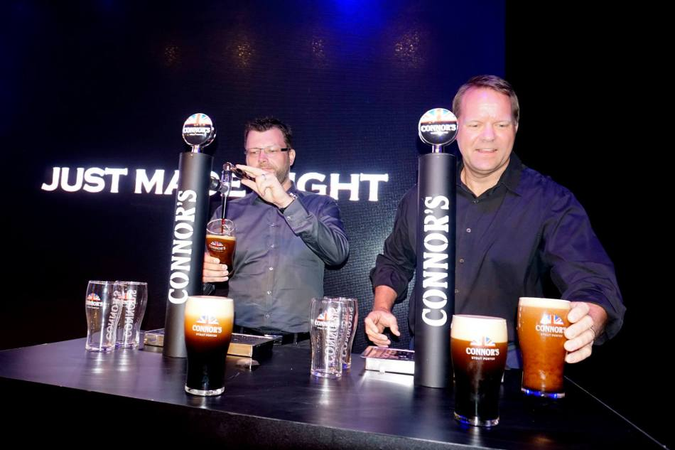 Kristian Dahl and Henrik Andersen pouring pints of Connor's Stout Porter