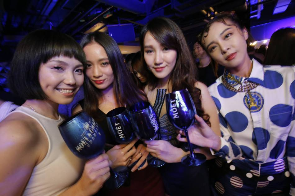 Daphne Ivory Chuah and Cathryn Lee with friends