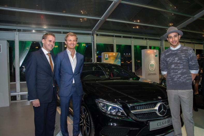 Mark Raine with Nico Rosberg and Louis Hamilton and the new Mercedes-Benz CLS 400