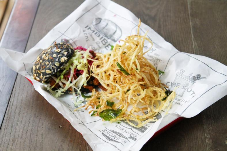 Sloppy Joe - A mouthwatering sloppy beef burger on own-made charcoal bread, pickled cabbage and onion string fries