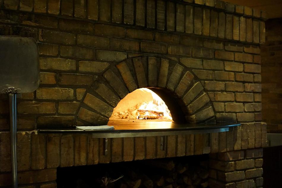 Large brick oven where the pizzas are baked