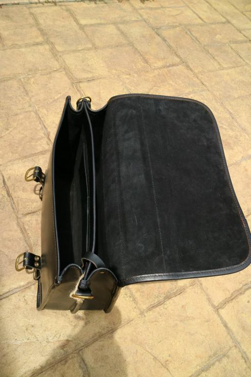 The inside has suede lining and is divided into two (2) separate compartments so you can put your laptop in one and your documents in the other