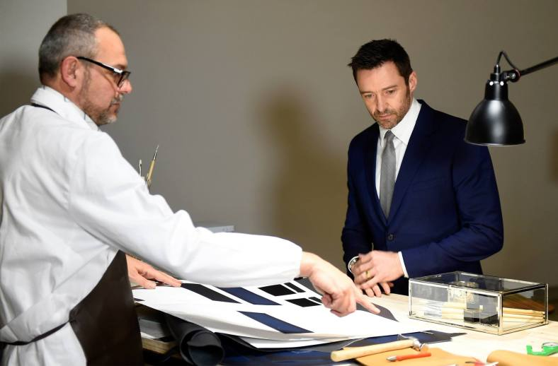 A Montblanc artisan demonstrating his skills and expertise to Hugh Jackman