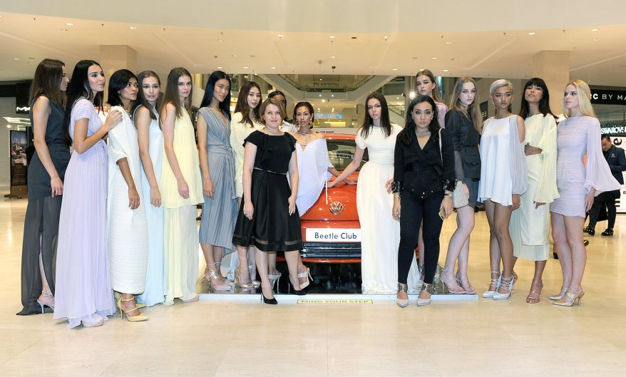 Alia with her models and the Volkswagen Beetle Club