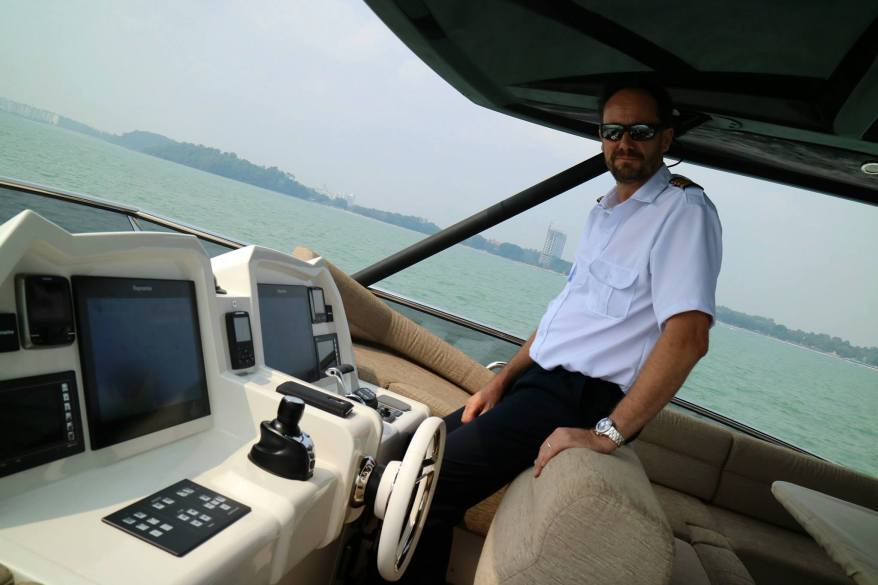 Captain Neil at the helm