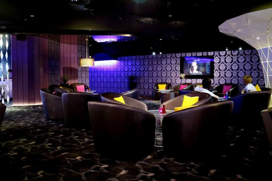 The lounge area which houses sofas and low tables - great for relaxing over some drinks while waiting for your movie