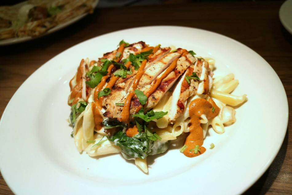 Chicken & Spinach Pasta (from the RM75.00 menu) - Penne pasta in creamy Alfredo sauce tossed with sauteed onions and bell peppers, fresh spinach, melted Jack cheese and and strips of chicken drizzled with chipotle pesto sauce