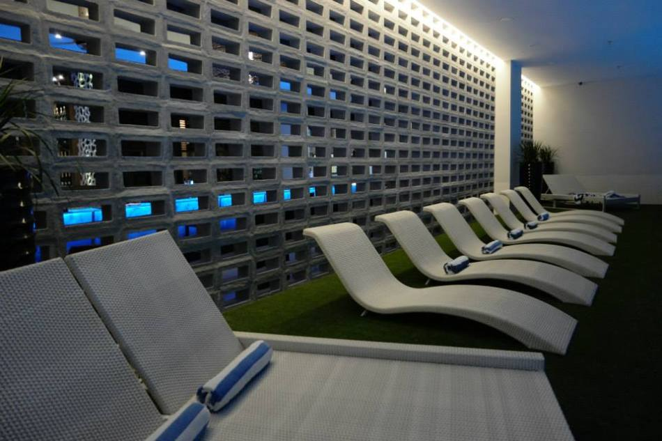 The deck chairs beside the pool