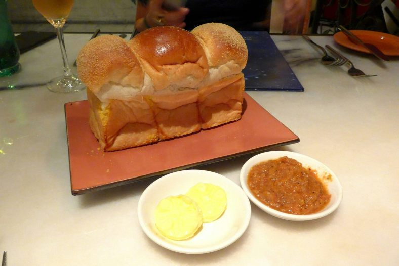 Complimentary bread served with butter and a tomato spread