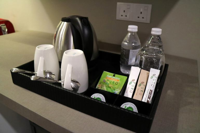 Bottled water, kettle and mugs and teabags to make drinks