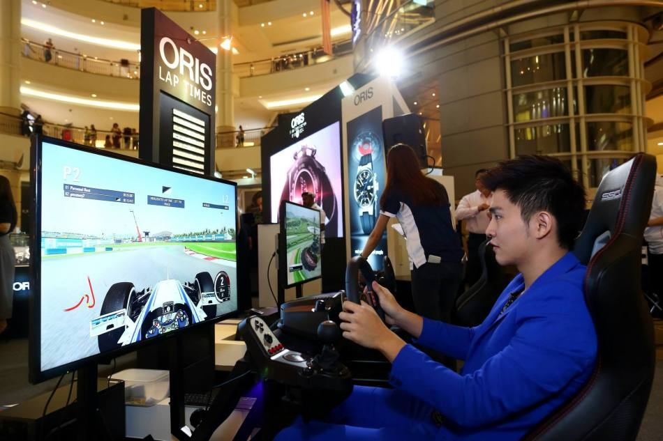 Guests trying out the racing simulator