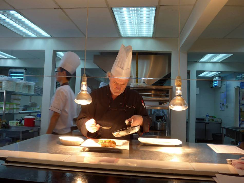 Chef Thierry preparing food in the open kitchen